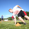 Danvers High School soon-to-be senior Drew Salvo rounds the corner on a drill during the Lineman Challenge at Masconomet Regional High School, a competition for local high school offensive and defensive linemen and run by Masco head football coach Jim Pugh. DAVID LE/Staff photo. 6/20/14.