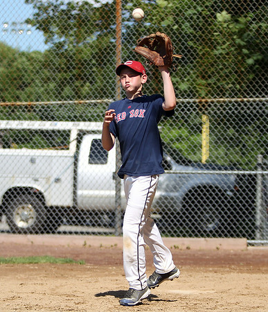 DJ Pachecco, of the Danvers National Williamsport team practices at Tapley Field in Danvers on Thursday afternoon. DAVID LE/Staff photo. 6/19/14.