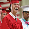 Masco graduate Christian Bates smiles at his family at the start of graduation on Friday evening. DAVID LE/Staff photo. 6/6/14.