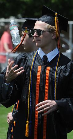 KEN YUSZKUS/Staff photo. Graduate Ty Martz juggles a water bottle as he waits for the Beverly High School graduation to begin.   6/1/14.