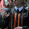 KEN YUSZKUS/Staff photo. Graduate Ty Martz juggles a water bottle as he waits for the Beverly High School graduation to begin.   6/1/14.