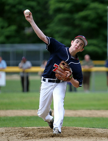 Peabody West starting pitcher Joe Gilmartin fires a pitch against Swampscott in District 16 action on Thursday evening. DAVID LE/Staff photo. 6/26/14.