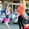 Eight-year-old Julia Spilman is spun around by her mother Lisa, while dancing along to music in Danvers Square during Oldies Night on Wednesday evening. DAVID LE/Staff photo. 6/25/14.