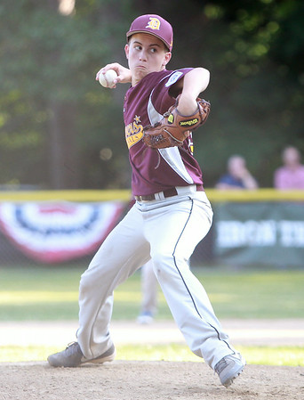 Danvers National starter Mike Morrill fires a pitch against Hamilton-Wenham on Monday evening. DAVID LE/Staff photo. 6/30/14.