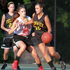 Bishop Fenwick rising senior captain Lexi Rose tries to dribble past a Masco defender on Monday evening. DAVID LE/Staff photo. 6/30/14.