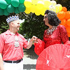 "John Nickerson, left, talks with Gary ""Gigi"" Gill at the annual Gay Pride Parade festivities at Salem Common on Saturday afternoon. DAVID LE/Staff photo. 6/21/14."