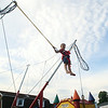 Five-year-old Hazen Walsh, of Middleton, flies high in the air on a bungee jump at Oldies Night in Danvers Square on Wednesday evening. DAVID LE/Staff photo. 6/25/14.