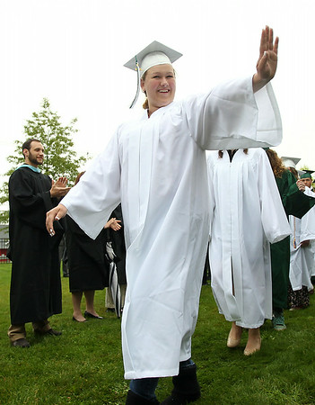Essex Aggie graduate Monika Hermance waves to friends as she proceeds into the tent during the final Commencement ceremony for the Essex Agricultural and Technical High School. Next year Essex Aggie and North Shore Technical High School will combine into one school. DAVID LE/Staff photo. 6/5/14.