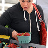 KEN YUSZKUS/Staff photo. Jessica Trioli of Salem picks some strawberries displayed by one of the vendors on the opening day of the farmers market, now in its 6th season.    6/12/14.