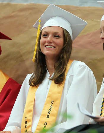 "Masconomet Regional High School Senior Class Treasurer Kathleen Gillespie smile as she listens to ""The Past, The Present, Shoes"" speech by Senior Class Vice-President John Mosbo during graduation on Friday evening. DAVID LE/Staff photo. 6/6/14."