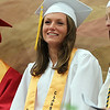 """Masconomet Regional High School Senior Class Treasurer Kathleen Gillespie smile as she listens to """"The Past, The Present, Shoes"""" speech by Senior Class Vice-President John Mosbo during graduation on Friday evening. DAVID LE/Staff photo. 6/6/14."""