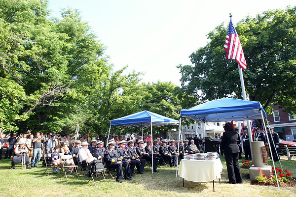 Many gathered in Lafayette Park in Salem to commemorate the 100th anniversary of the Great Salem Fire of 1914. Mayor Kim Driscoll and Salem Fire Chief David Cody handed out plaques to fire chief from departments that responded to help during the great fire. DAVID LE/Staff photo. 6/25/14.