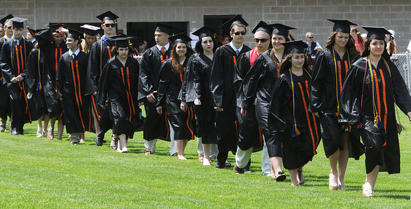 KEN YUSZKUS/Staff photo. Graduates march during the processional onto the field at Hurd Stadium for the Beverly High School graduation.   6/1/14.
