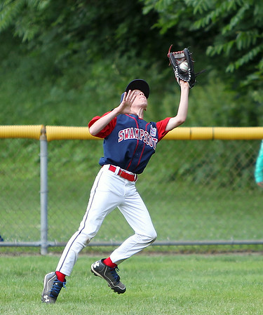 Swampscott right fielder Miles Benson hauls in a fly  ball to retire a Peabody West batter on Thursday evening. DAVID LE/Staff photo. 6/26/14.