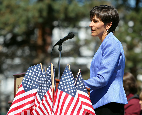 Kara McLaughlin, Executive Director of the House of Seven Gables in Salem gives welcoming remarks during a Naturalization ceremony on the back lawn of the House of Seven Gables in Salem on Friday afternoon. DAVID LE/Staff photo. 6/27/14.