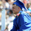 "Danvers High School graduate Anthony Cordoba flashes a smile while listening to classmate Ryan Heber's speech ""Gibberish: An Art Form"" during graduation on Saturday afternoon. DAVID LE/Staff photo. 6/7/14."