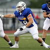 St. John's Prep offensive lineman Domenic Hooven (58) blocks against the South during the 53rd Agganis Football game at Manning Field in Lynn on Thursday evening. DAVID LE/Staff photo. 6/26/14.