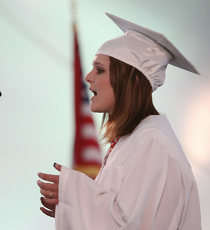 Essex Aggie graduate Francesca Weeks sings the National Anthem during the final Commencement ceremony for the Essex Agricultural and Technical High School. Next year Essex Aggie and North Shore Technical High School will combine into one school. DAVID LE/Staff photo. 6/5/14.
