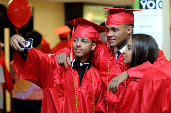KEN YUSZKUS/Staff photo. From left, Abel Nunez, Juan Martinez Rodriguez, and Yanna Noboa pose for a photo before the start of the Salem High School graduation.  6/6/14.