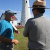 KEN YUSZKUS/Staff photo.   Lighthouse keeper Greg Gukenburg, left, speaks with Paul DePrey of the National Park Service at Bakers Island Light Station.   6/30/15