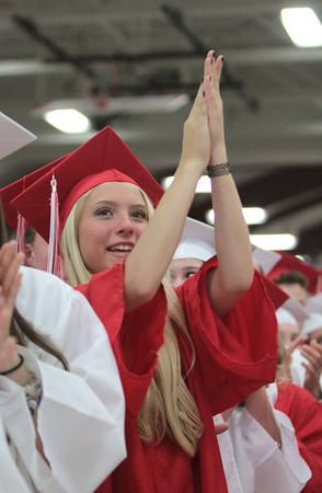 Nicole Goodhue Boyd/Photo<br /> Hannah Bradshaw applauds during Graduation Friday, June 5, at Masconomet Regional High School.
