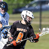 DAVID LE/Staff photo. Ipswich junior captain Kilian Morrissey (8) spins away from the stick check of a Dover-Sherborn player. 6/14/16.