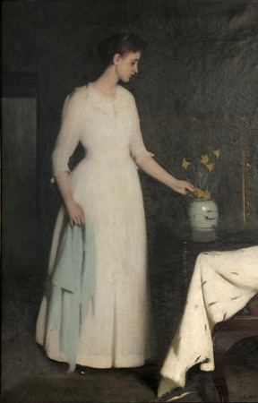 """KEN YUSZKUS/Staff photo.    """"Lady in White"""" painting by Frank Benson hangs in the Salem Public Library.      06/13/16"""