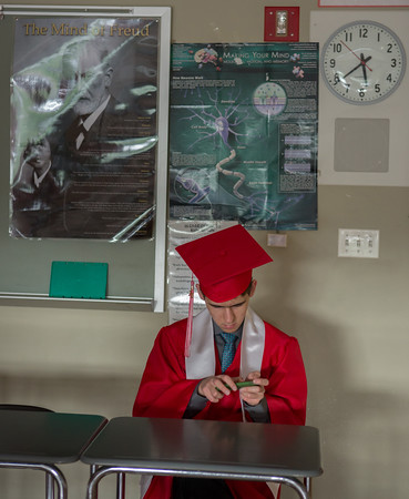 Kyle Sherrick spends his last time in his room before graduation ceremonies start at Masconomet Regional High School graduation, Friday, June 3rd, 2016. JARED CHARNEY/Photo.<br /> June 3, 2016