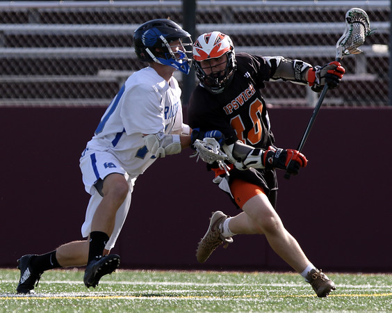 DAVID LE/Staff photo. Ipswich sophomore Pat Gillis (10) tries to juke his way past a Dover-Sherborn defender. 6/14/16.