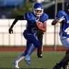 DAVID LE/Staff photo. Methuen quarterback Kendrick Denose (8) sprints left on a quarterback keeper. 6/30/16.