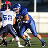 DAVID LE/Staff photo. Methuen's Christopher Saba (72) lead blocks for a running play. 6/30/16.