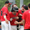 DAVID LE/Staff photo. North Andover's Joe Quinlan gets mobbed by his teammates after launching a solo home run off Danvers starting pitcher Dean Borders. 6/9/16.