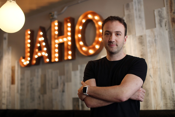 DAVID LE/Staff photo. Anil Menzini is the owner of Jaho Coffee and Tea at the head of Pickering Wharf in Downtown Salem. Menzini has opened another Jaho location in Boston, in the Chinatown District, and will shortly be opening a new shop, The Coffee Experiment, on Main Street in Downtown Peabody. 6/23/16.
