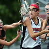 DAVID LE/Staff photo. Ipswich senior Renee DiNocco (5) and junior Chloe Rogers (7) double team Marblehead freshman Grace Arthur, center. 6/9/16.