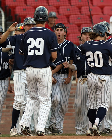 DAVID LE/Staff photo. St. John's Prep junior Sam Blizard greets junior Andrew Selima (29) after his two-run second inning homer against Braintree in game one of the Super 8 Final. 6/16/16.