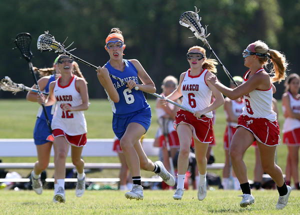 DAVID LE/Staff photo. Danvers senior captain Allie Zunick keeps her eyes upfield as she tries to lead a Falcon breakaway while she gets surrounded by three Masco defenders. 6/2/16.