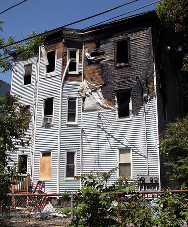 DAVID LE/Staff photo. Cleanup for a house fire at 17 Littles Lane in Peabody began on Saturday morning after a fire the previous night. 6/18/16.