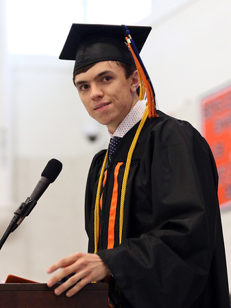 DAVID LE/Staff photo. Beverly High School Salutatorian Samuel Peterson delivers his address to his classmates and a packed gymnasium at Beverly High School on Sunday afternoon. 6/5/16.
