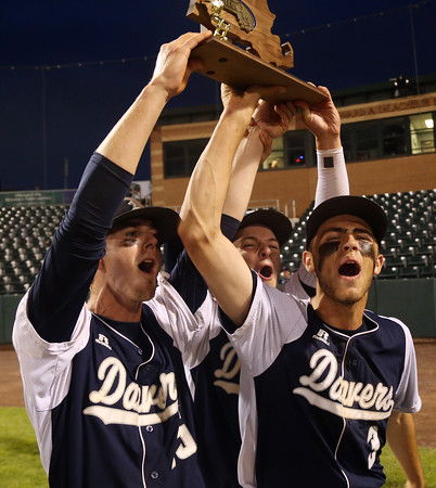 DAVID LE/Staff photo. Danvers senior captains Andrew Olszak, Danny Lynch and Tim Unczur, hoist the D2 North championship trophy over their heads after capturing the title with a 9-4 win over Reading at LeLacheur Park in Lowell on Sunday evening. 6/11/16.