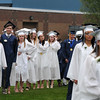 PAUL BILODEAU/Staff photo. Students line up on the football field before entering the tent for graduation during Hamilton-Wenham Regional High School's graduation ceremony in a tent on the football field at the school.