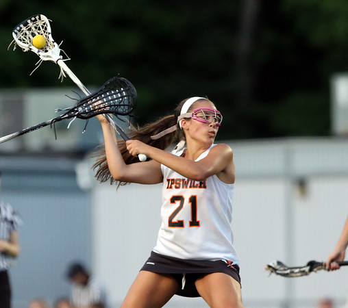 DAVID LE/Staff photo. Ipswich senior attack Abby Porter winds up for a shot on a free position on Tuesday. 6/7/16.