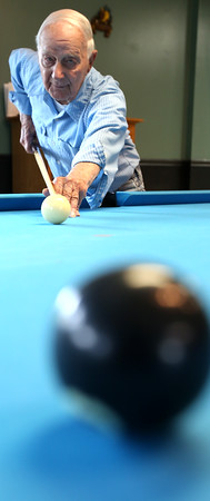 KEN YUSZKUS/Staff photo.    Joe Fielding, who is almost 95 years old, plays eight ball at the Peter A. Torigian Senior Center in Peabody.      06/07/16