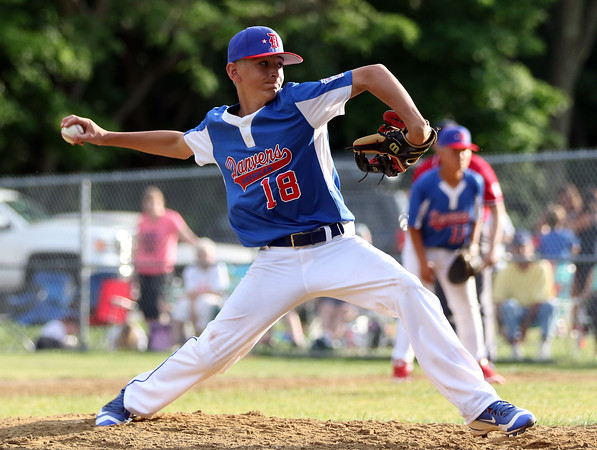 DAVID LE/Staff photo. Danvers' starting pitcher James Carmelia throw a pitch against Beverly in District 15 opening round action on Wednesday evening. 6/29/16.