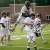 Beverly: During the North Division 2 playoff quarterfinal held at Endicott College on Saturday afternoon. Beverly beat Burlington 14-9. Beverly's Noah Kaplan, left, and Ewan Sellars, right, react to winning the game. At center, Nick DiLuiso, leaping over Kevin Morency after the game, scored six goals during the game. Photo by Allegra Boverman