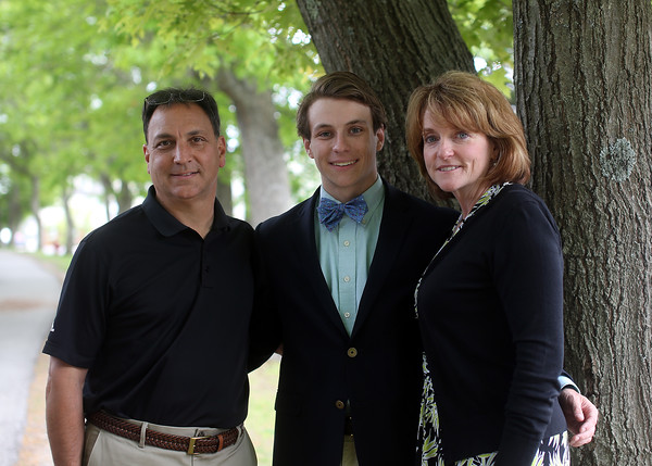 DAVID LE/Staff photo. Andrew Medros, of Wilmington, will be graduating from the Landmark School in Beverly on Saturday. Medros has spent years battling dyslexia while also helping raise awareness of diabetes, another condition he suffers from. Medros stands with his parents Rob and Christine on Friday afternoon. 6/3/16.