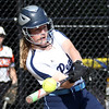 DAVID LE/Staff photo. Peabody six hitter Lexie Zammer lofts a sacrifice fly to right against Beverly on Wednesday afternoon. 5/25/16.