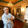 KEN YUSZKUS/Staff photo.     John McInnis of John McInnis Auctioneers speaks about the upcoming Henry Audesse mansion auction from inside the home.     06/28/16