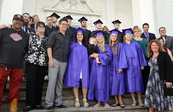RYAN HUTTON/ Staff photo<br /> The graduates and staff of the Northshore Recovery High School pose for a group photo before the start of the school's commencement ceremony on the steps of the Second Congregational Church in Beverly on Wednesday night.