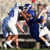 DAVID LE/Staff photo. Methuen's Saul Cabrera engages on a block with Pingree's Danya Smith (50). 6/30/16.