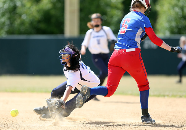 DAVID LE/Staff photo. Swampscott senior baseman Katie Watts tries to make a diving stop on a sharply hit grounder as Tewksbury senior Nora Butler (6) tries to avoid contact. 6/12/16.